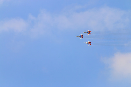 mig: PERM, RUSSIA - JUN 27, 2015: Three Mig 29 fighter aircrafts on airshow Wings of Parma