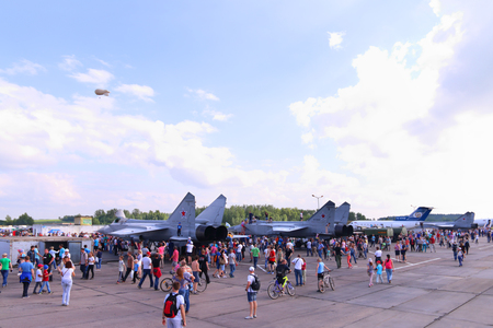 crowd tail: PERM, RUSSIA - JUN 27, 2015: People near military aircrafts during airshow Wings of Parma Editorial