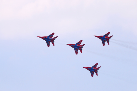 mig: PERM, RUSSIA - JUN 27, 2015: Four Mig 29 fighter planes team perform on airshow Wings of Parma