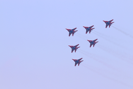 mig: PERM, RUSSIA - JUN 27, 2015: Six Mig 29 fighter planes fly in sky on airshow Wings of Parma