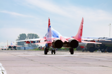 mig: PERM, RUSSIA - JUN 27, 2015: Two Mig 29 Swifts accelerated on runway on airshow Wings of Parma