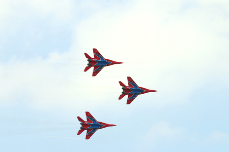 mig: PERM, RUSSIA - JUN 27, 2015: Three Mig 29 fighter aircrafts fly away in sky on airshow Wings of Parma Editorial