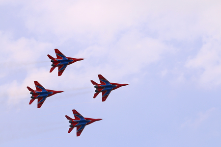 mig: PERM, RUSSIA - JUN 27, 2015: Four Mig 29 fighter planes team Swifts fly in sky on airshow Wings of Parma