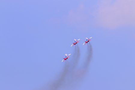 mig: PERM, RUSSIA - JUN 27, 2015: Three Mig 29 fighter aircrafts perform on airshow Wings of Parma