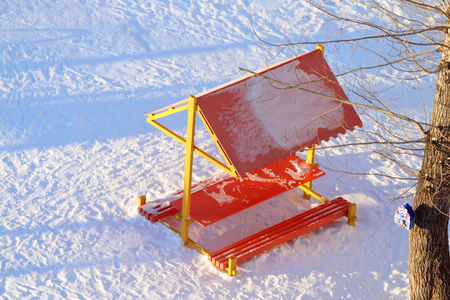 arbor: Top view wooden arbor at children playground covered by snow at winter day Stock Photo