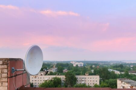 satelite: Satelite Dish and residential area and beautiful pink sky during evening