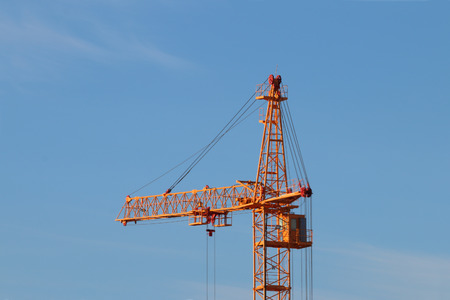 Tall Yellow Stationary Hoist Construction Site And Blue Sky At