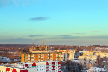 perm: Residential area with buildings in snow at sunny winter evening in Perm, Russia
