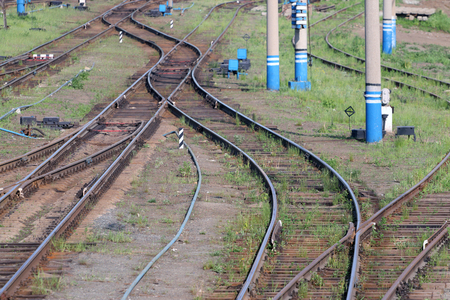 turnouts: Railways with wooden sleepers, poles, grass and turnouts at summer