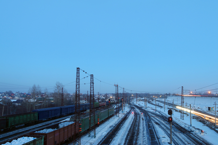freightliner: Freight trains with carriages stand on railways at snowy winter evening