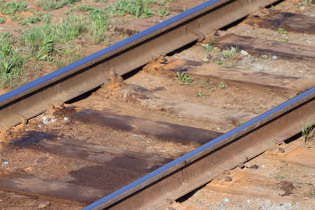 turnouts: Close up view of railway with wooden sleepers and green grass Stock Photo
