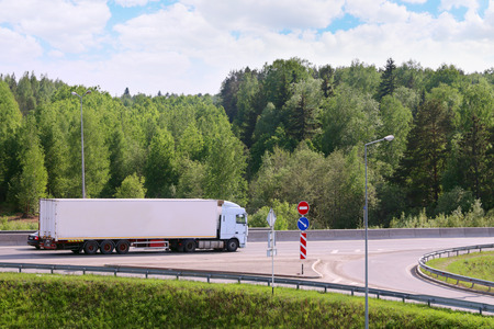 spent: PERM, RUSSIA - MAY 30, 2015: Truck on road. In 2015, in Perm in repair of roads 2.6 billion dollars spent Editorial