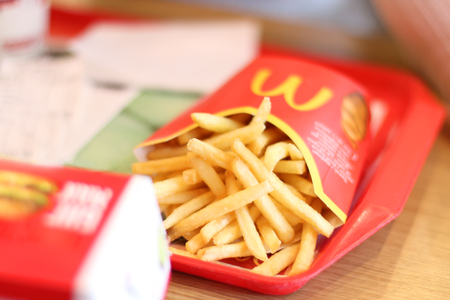 PERM, RUSSIA - MAY 15, 2015: French fries in McDonalds restaurant. McDonalds Corporation - US corporation, large network of fast-food restaurants, working on franchise system