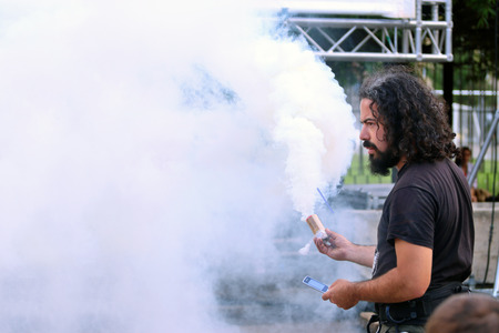 perm: PERM, RUSSIA - JUN 5, 2015: Man holding smoke flare at Perm Kaleidoscope Festival