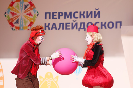 perm: PERM, RUSSIA - JUN 5, 2015: Clowns hold ball on open air stage at Perm Kaleidoscope Festival