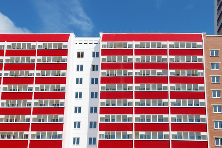 stanza: Part of pink residential building with many red loggias at sunny day