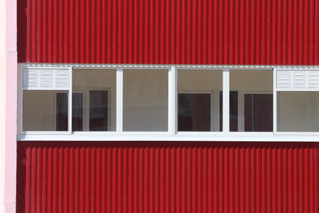 prefab: Part of residential building with loggias with double glazing at sunny day Stock Photo