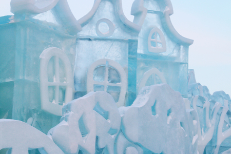 Part of ice fairytale house with windows outdoor at winter frost day