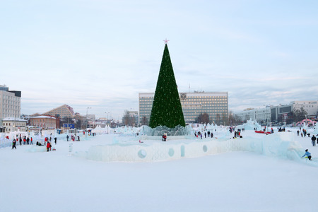 PERM, RUSSIA - JAN 18, 2017: Christmas tree and Perm Ice Town 2017 Ekosad with sculptures - largest in Russia at day