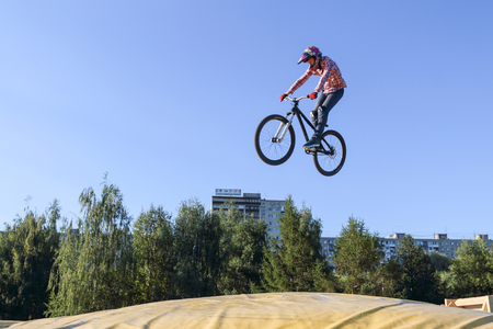PERM, RUSSIA - August 20, 2016: The cyclist makes the extreme jump in aeromat, nicely caught in the frame as the guy hung in the air