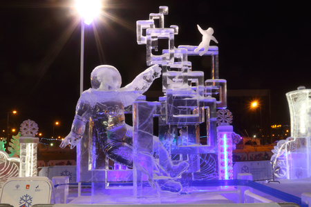 PERM, RUSSIA - FEB 1, 2017: Sculpture Space traveler at night, Ice town of Perm in 2017 Ekosad - largest in Russia Editorial