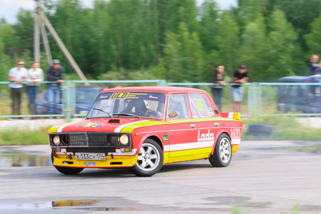ural: PERM, RUSSIA - JUL 22, 2017: Drifting red car on race wet track at Open Ural Championship Drift 2017 Editorial