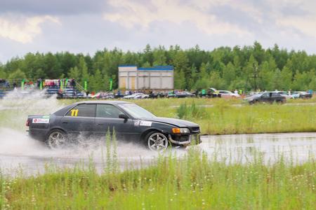PERM, RUSSIA - JUL 22, 2017: Drifting black car on track during Open Ural Championship Drift 2017 Editorial