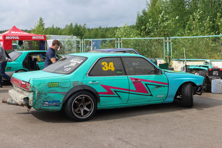 PERM, RUSSIA - JUL 22, 2017: Green competitor car at Open Ural Championship Drift 2017