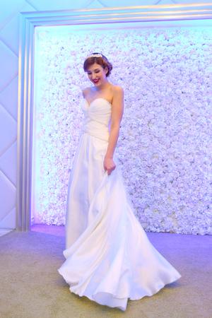 PERM, RUSSIA - FEB 12, 2017: Pretty model bride in lond dress poses at Wedding Fair Perm 2017