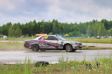 PERM, RUSSIA - JUL 22, 2017: Drifting modern car move on wet asphalt track at Open Ural Championship Drift 2017 Editorial
