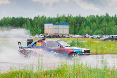 PERM, RUSSIA - JUL 22, 2017: Drifting car on wet track during Open Ural Championship Drift 2017 Editorial