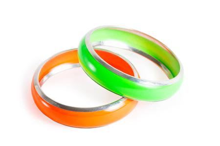 Two plastic stylish women bracelets - green and orange isolated on white Stock Photo