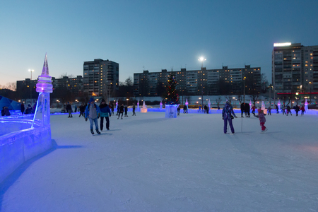 PERM, RUSSIA - FEB 12, 2018: Public ice rink in Ice Town was maked for FIFA 2018 World in Russia at evening Editorial