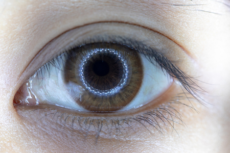Close up of beautiful woman eye and contact lens. 版權商用圖片