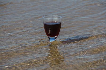 seawater: One wine glass stand in the seawater