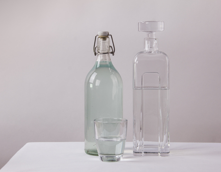 unhealthful: Clean and dirty drinking water in bottle, carafe and glass