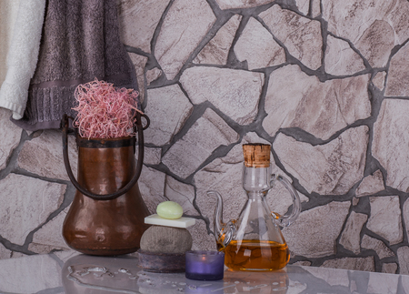 Special oil, bronze boiler for water, towel, candle and soap for cleansing and aromatherapy