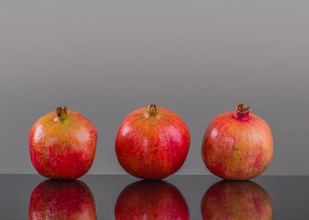 identical: Three big pomegranate Stock Photo