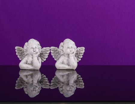 imperturbable: Christmas decoration. Two figurines of dreamily angels twin Stock Photo