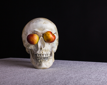 The skull full face smelling and watching  with apple eyes Stock Photo
