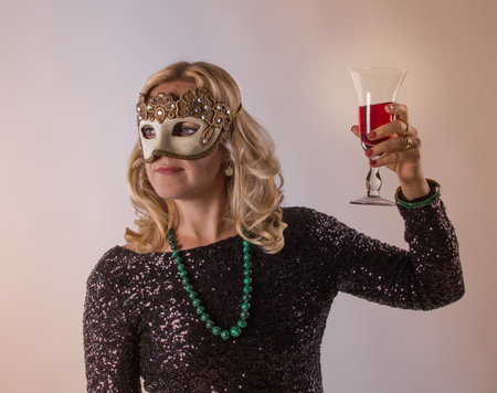 oddity: Luxury woman with black dresswith glitter makes a majestic gesture with red drink