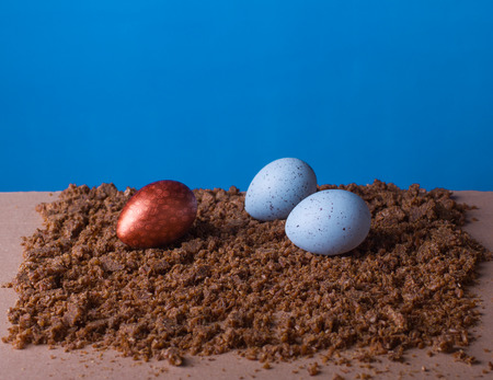 striated: Easter eggs on the blue background Stock Photo