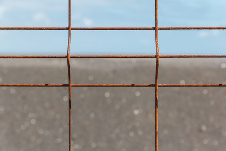 corrosion: Iron fence with corrosion before horizon close-up.