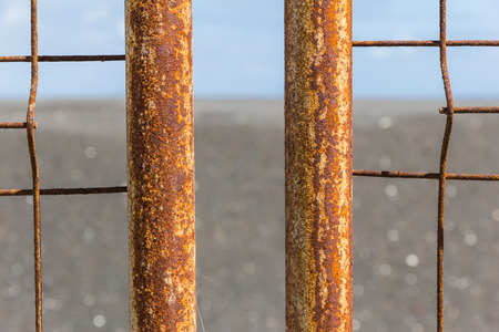 boundary: Iron fence with corrosion before ocean in La Palma.