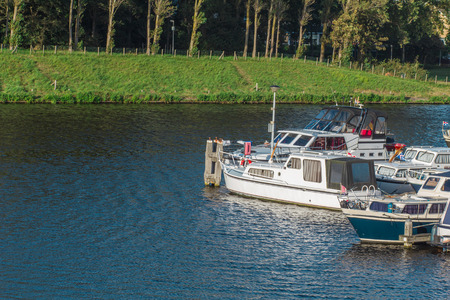waterfront property: Wharf of boats in a small place of canal in Netherlands