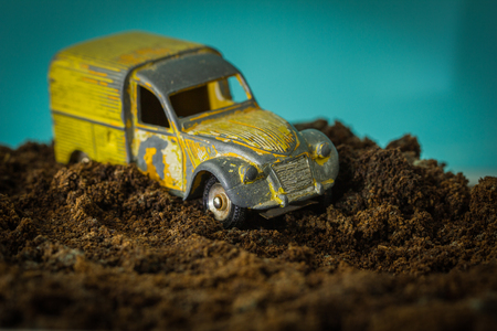 insurmountable: 3 d model yellow car bogged down