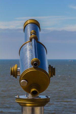 Operated Binocular on the coast of  North Sea outdoor in Netherlands