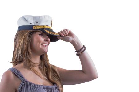 Happy valiant daring brunette holds the marine cap, on the white background, horizontal Banco de Imagens