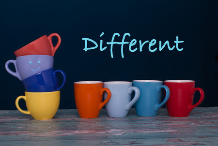 Eight different cups of coffee of vibrant colors on the table. Concept.