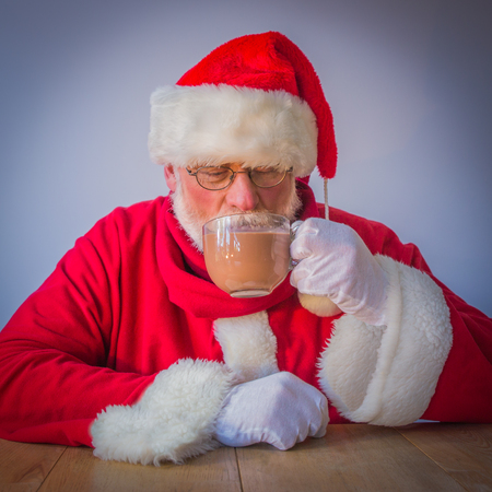 Santa Claus with glas of cacao Stock Photo